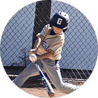 youth baseball player hitting ball