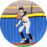 youth baseball player throwing ball