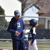 youth baseball coach with player