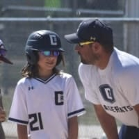 baseball coach with youth player